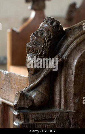 Medieval bench end carving in St. Peter`s Church, Great Walsingham, Norfolk, England, UK - Stock Photo