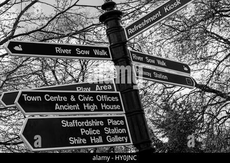 Monochrome image of a direction signpost in Victoria Aprk, Stafford - the park is located along the River Sow - Stock Photo