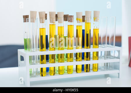 Close-up view of test tubes with colorful chemical samples in lab - Stock Photo