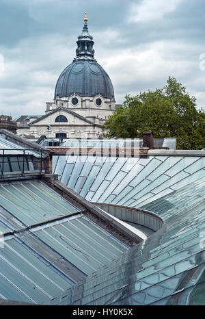 View of Brompton Oratory across new glazed roof reflecting sky clouds and dome and new gallery glass roof at the - Stock Photo