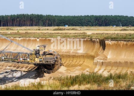 Bucket wheel excavator in a lignite mine. Coal mining in germany. - Stock Photo