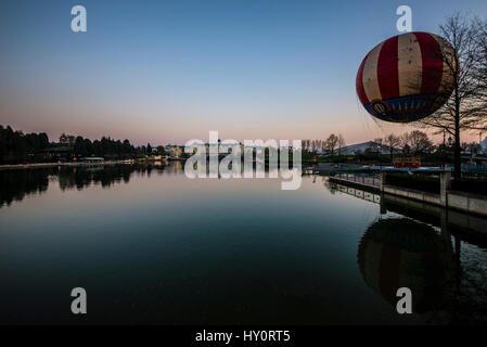 Newport Bay Club hotel and Panoramagique balloon at Disneyland Paris EuroDisney, viewed from across Lake Disney - Stock Photo