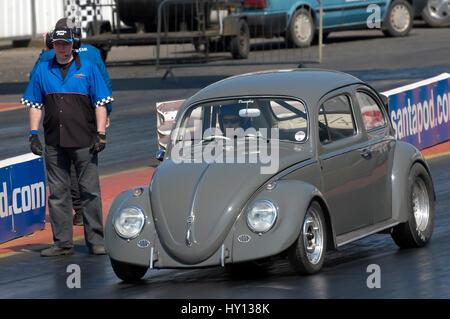 Santa Pod, UK - April 23, 2010: Big Bang Camper and Bus Festival. Road legal VW Beetle dragster on the quarter mile - Stock Photo