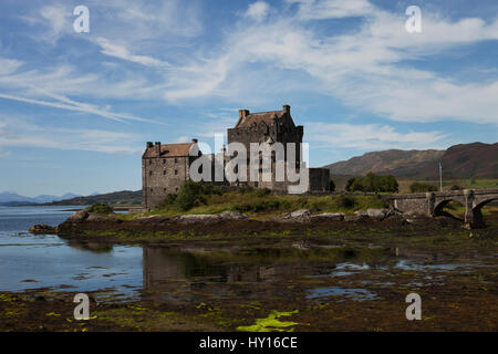 United Kingdom, Scotland, Dornie, Eilean Donan Castle reflecting in water - Stock Photo