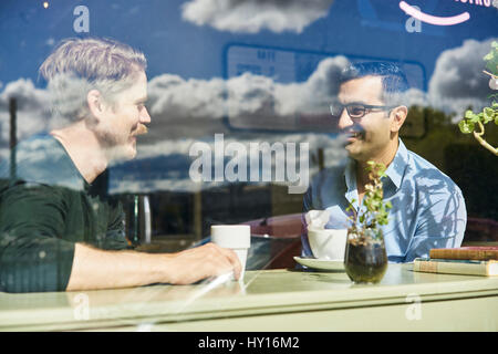 Sweden, Portrait of two mid adult men in cafe - Stock Photo
