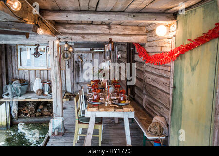 Sweden, Patio with fresh crayfish on wooden table at crayfish party - Stock Photo