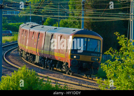 EWS Class 325 325014 in Royal Mail livery seen on the West Coast main line at Winwick junction. - Stock Photo