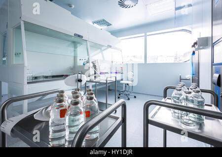 Pharmaceutical industry factory and production laboratory (color toned image; shallow DOF) - Stock Photo