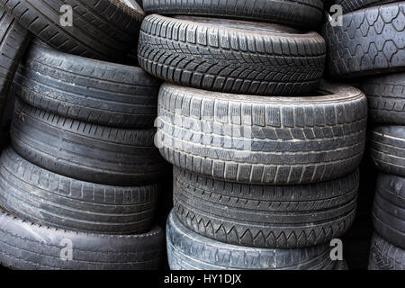 Tires for sale at a tire store - stacks of old used tires - Stock Photo