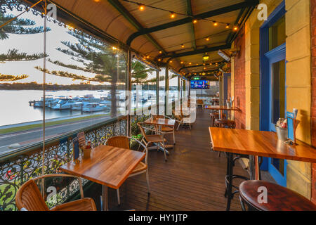 View from the balcony of a typical turn of the century pub, overlooking a marina on the Swan River, Fremantle, Perth, - Stock Photo