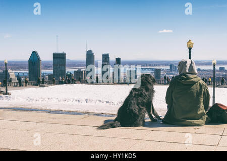 Montreal, CA - 30 March 2017: People enjoying a sunny spring day on Kondiaronk Belvedere - Stock Photo