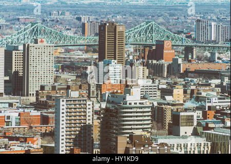 Montreal, CA - 30 March 2017: Ville-Marie disctrict and Jacques Cartier Bridge - Stock Photo