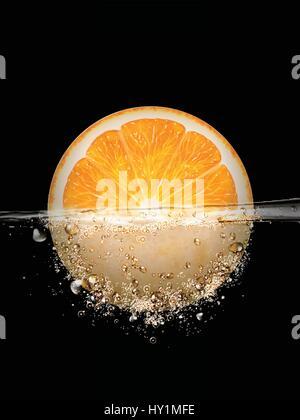 sliced orange floating in water, 3d illustration - Stock Photo