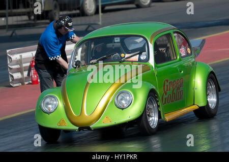Santa Pod, UK - April 23, 2010: Big Bang Camper and Bus Festival. Green Goblin VW Beetle on the drag strip. - Stock Photo