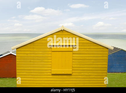 Brightly Coloured Beach Huts at the  Beach of Whitstable on the North Sea coast of South East England.   Bunte Strandhuetten - Stock Photo