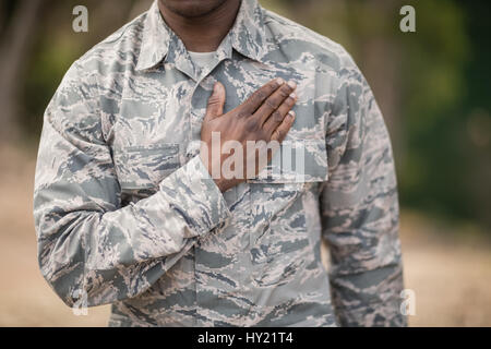 Mid section of soldier taking pledge in boot camp - Stock Photo