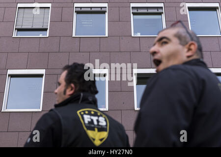 Berlin, Berlin, Germany. 31st Mar, 2017. Employees of the security company Fulltime Service GmbH demonstrate in - Stock Photo