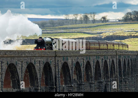 Ribblehead, North Yorkshire, UK. 31st March 2017. The iconic steam locomotive LNER class A3 60103 Flying Scotsman, - Stock Photo