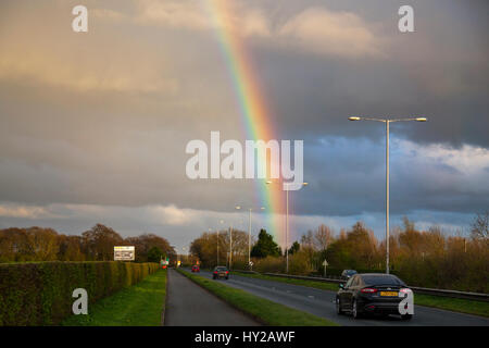 Tarleton, Lancashire, UK. UK Weather. 31st March, 2017. Sunset, showers and evening rainbow over the farmlands of - Stock Photo
