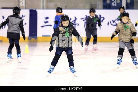 (170401) -- SHANGHAI, April 1, 2017 (Xinhua) -- Children practice skating in Feiyang Skating Center in Shanghai, - Stock Photo