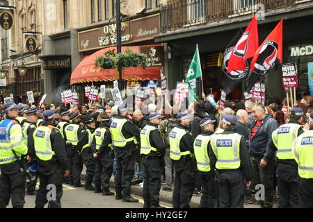 London, UK. April 1st, 2017. The anti-racism demo is surrounded by police in Whitehall. Far right groups Britain - Stock Photo
