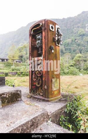 Heavily rusted, antique gas pump in the remote jungle near Lake Atitlan, Guatemala, Central America. - Stock Photo