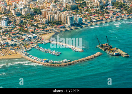 Sea port city of Larnaca, Cyprus.  View from the aircraft to the coastline, beaches, seaport and the architecture - Stock Photo