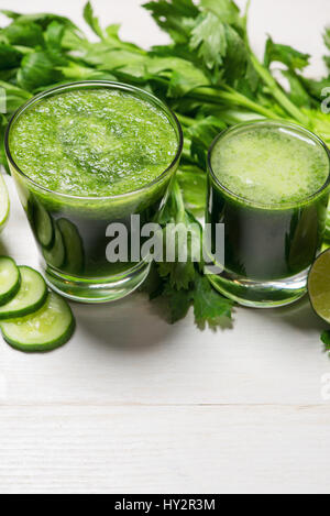 Detox concept. Glass jar of fresh drink green smoothie, spinach leaves, cucumber, apple, lime fruit. - Stock Photo