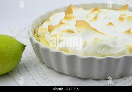 Lemon custard pie with meringue topping - Stock Photo