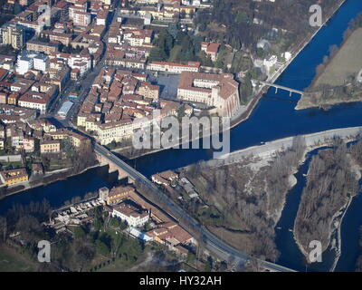 Aerial view of Cassano d'Adda with the Adda River flowing near the castle. - Stock Photo