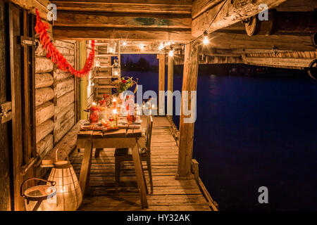 Sweden, Patio with fresh crayfish on wooden table - Stock Photo
