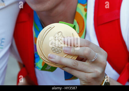 Sport, Olympics, Athlete holding gold medal from Rio games 2016. - Stock Photo
