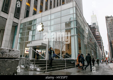 New York, Feburary 9, 2017: The front of the 5th Avenue Apple store's new location previously occupied by FAO Schwartz. - Stock Photo