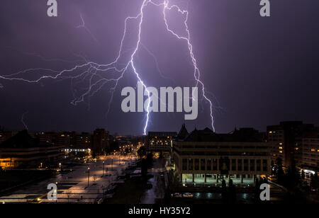 Lightning storm over the city. Thunderstorm and lightning over the city. - Stock Photo