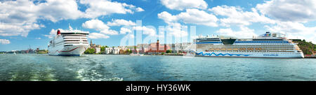 STOCKHOLM, SWEDEN - JUNE 25: View to Stockholm from seaside on June 25, 2016 in Sweden. Two ferries are at bay near - Stock Photo