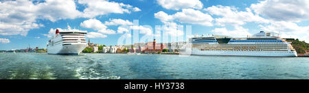 SView to Stockholm from seaside in Sweden. Two ferries are at bay near stockholm on beautiful sunny day. - Stock Photo