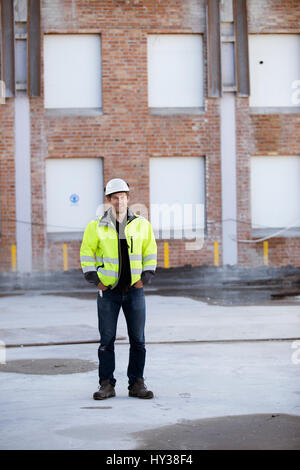 Sweden, Portrait of man with building in background - Stock Photo