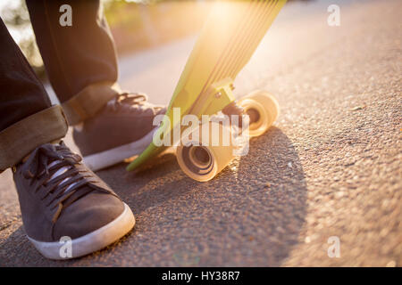 Sweden, Feet of man with skateboard - Stock Photo