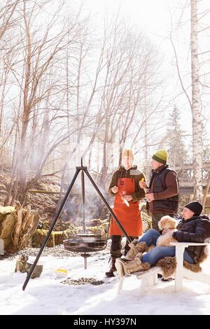 Sweden, Vastmanland, People having barbecue - Stock Photo