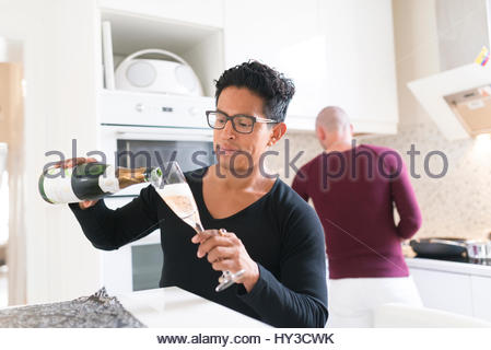 Norway, Couple in domestic kitchen - Stock Photo