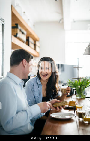 Germany, Couple during breakfast - Stock Photo