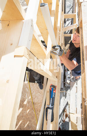 Sweden, Sodermanland, Carpenters working on construction site - Stock Photo