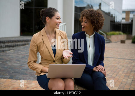Portrait of two businesswomen interacting with each other in the office premises