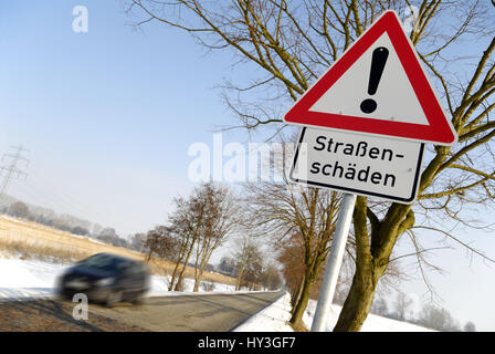 Hard winter: Warning street damages, Harter Winter: Warnschild Straßenschäden