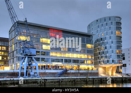 The harbour city in Hamburg with the Me?mer Momentum and residential tower oval, Germany, Europe, Die Hafencity - Stock Photo