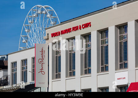 Bournemouth - Big Wheel towers behind Harry Ramsden world famous fish & chips at Bournemouth seafront, Pier Approach - Stock Photo