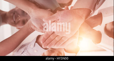 Close-up of business people staking hand at office - Stock Photo