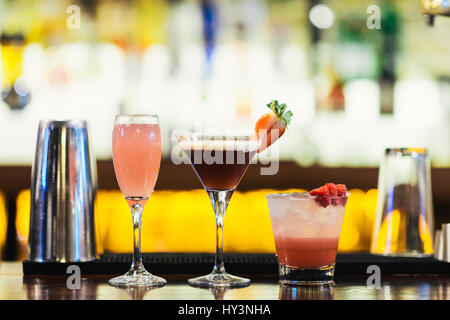 Row of Colourful Cocktails on a Bar Counter - Stock Photo
