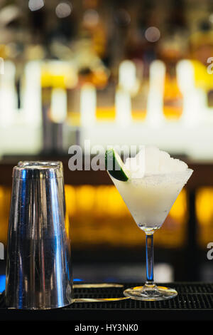Glass of Margarita Cocktail on Crushed Ice - Stock Photo
