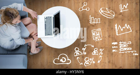 Woman on her laptop against wooden planks - Stock Photo